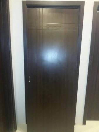 تصميمات خشب لابواب الشقق الداخلية والخارجية (2)